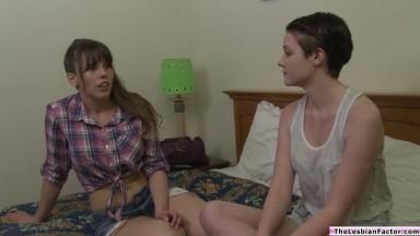 A brunette babe fingered by lesbian milf